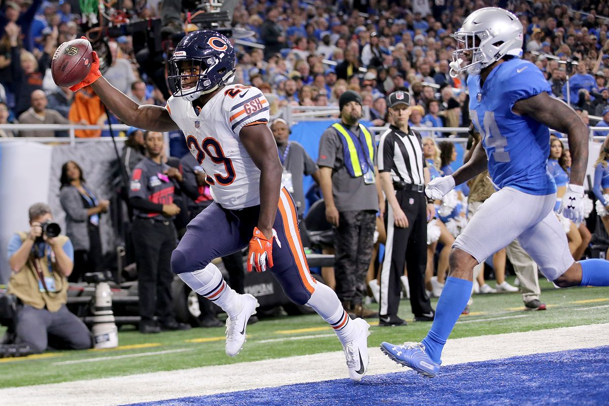 Tarik Cohen  29 of the Chicago Bears catches a touchdown pass in front of  Nevin Lawson  24 of the Detroit Lions during the third quarter at Ford  Field on ... 03f4c4fa1