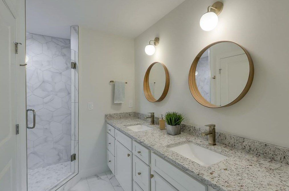 A master bathroom with dual sinks.