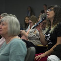 """Kate Kelly asks a question of Michael Otterson, managing director of Public Affairs for The Church of Jesus Christ of Latter-day Saints, during the 2016 Mormon Studies Conference on the topic of """"Mormonism and the Art of Boundary Maintenance"""" at Utah Valley University in Orem, Utah, Tuesday, April 12, 2016."""