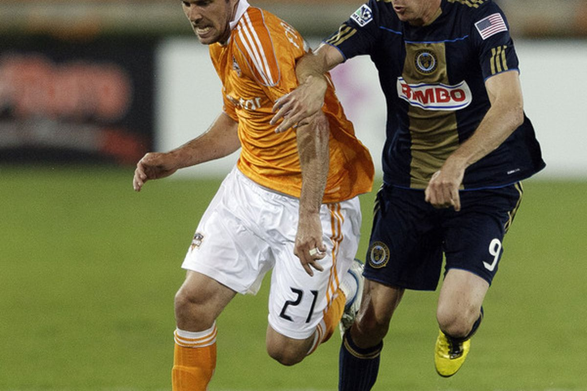 HOUSTON, TX - MARCH 19:  Will Bruin #21 of the Houston Dynamo is harrassed by Sebastien Le Toux #9 of the Philadelphia Union as he brings the ball up field at Robertson Stadium on March 19, 2011 in Houston, Texas.  (Photo by Bob Levey/Getty Images)
