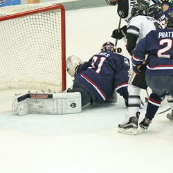 UConn's Rob Nichols (31) protects his net during a scramble in front of him.