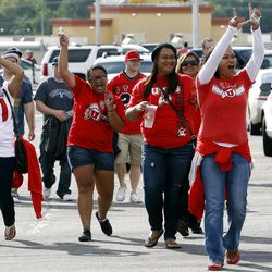 Utah fans cheer as they walk towards the stadium as BYU and Utah get set to play Saturday, Sept. 17, 2011 at Lavell Edwards Stadium.