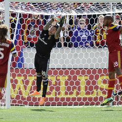 Real Salt Lake goalkeeper Nick Rimando (18) makes a save during a game at Rio Tinto Stadium on Saturday, March 22, 2014.