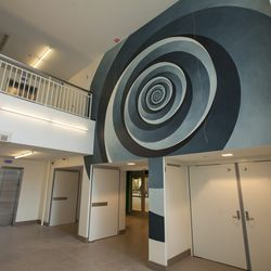 """Miami's Bhakti Baxter added this swirly number (""""Circle Spiral"""") to a wall on the second level of the space."""