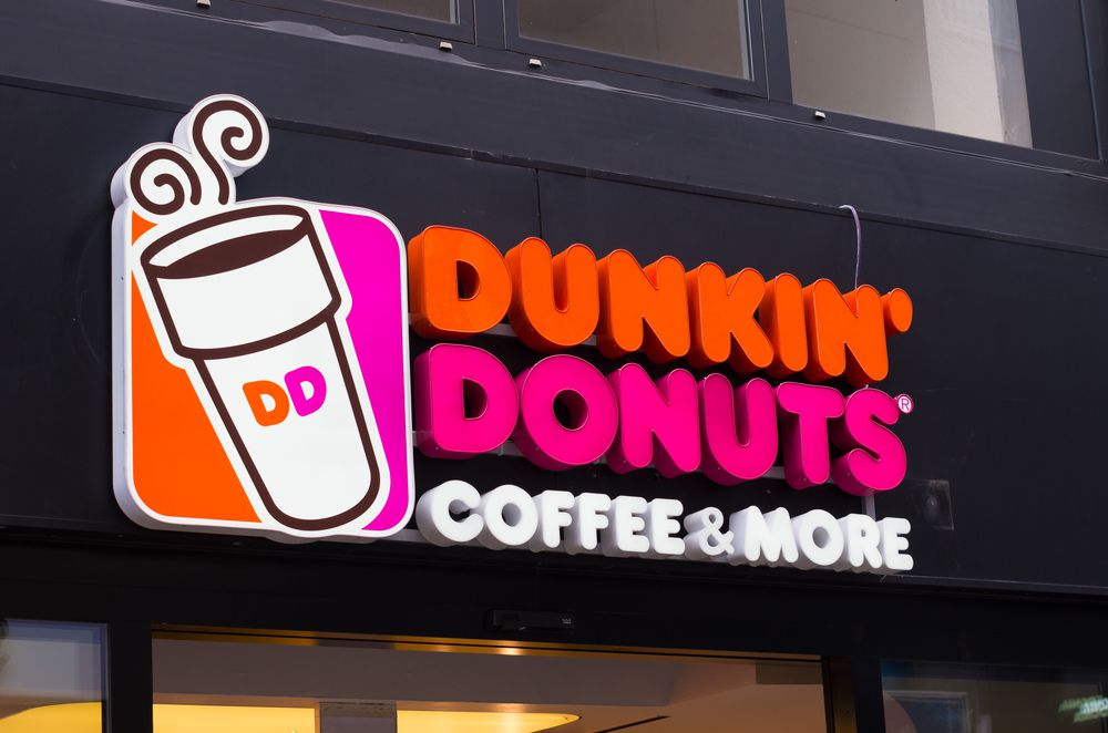 A Dunkin' Donuts sign bearing its registered trademark.