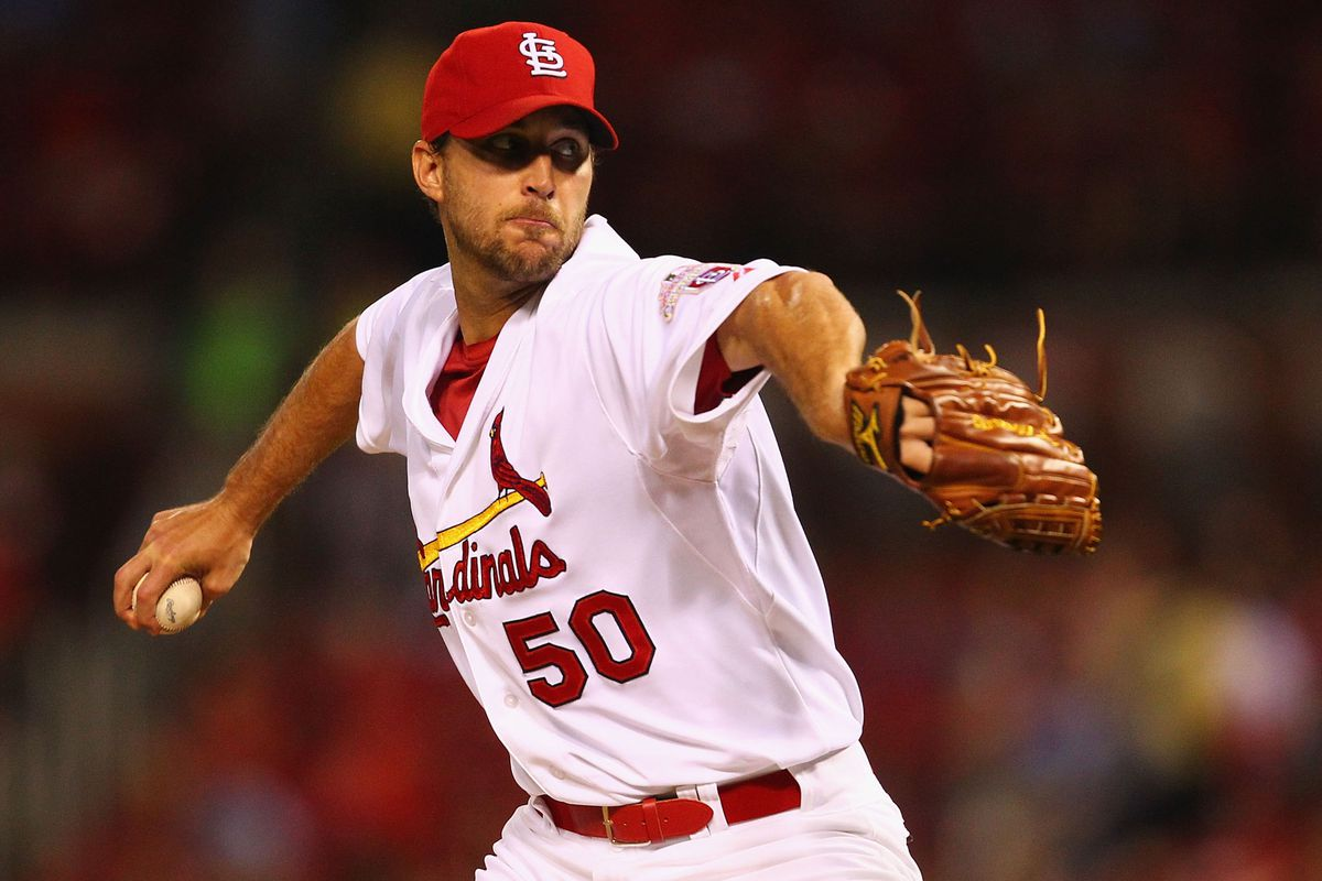 ST. LOUIS, MO - AUGUST 15: Starter Adam Wainwright #50 of the St. Louis Cardinals pitches against the Arizona Diamondbacks at Busch Stadium on August 15, 2012 in St. Louis, Missouri.  (Photo by Dilip Vishwanat/Getty Images)