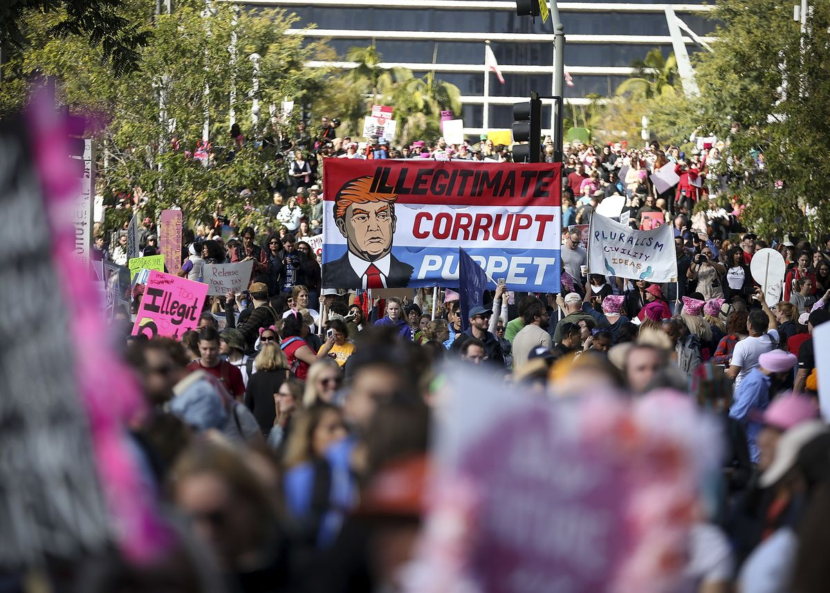Marchers hold signs during the Women's March on January 21, 2017 in Los Angeles, California.