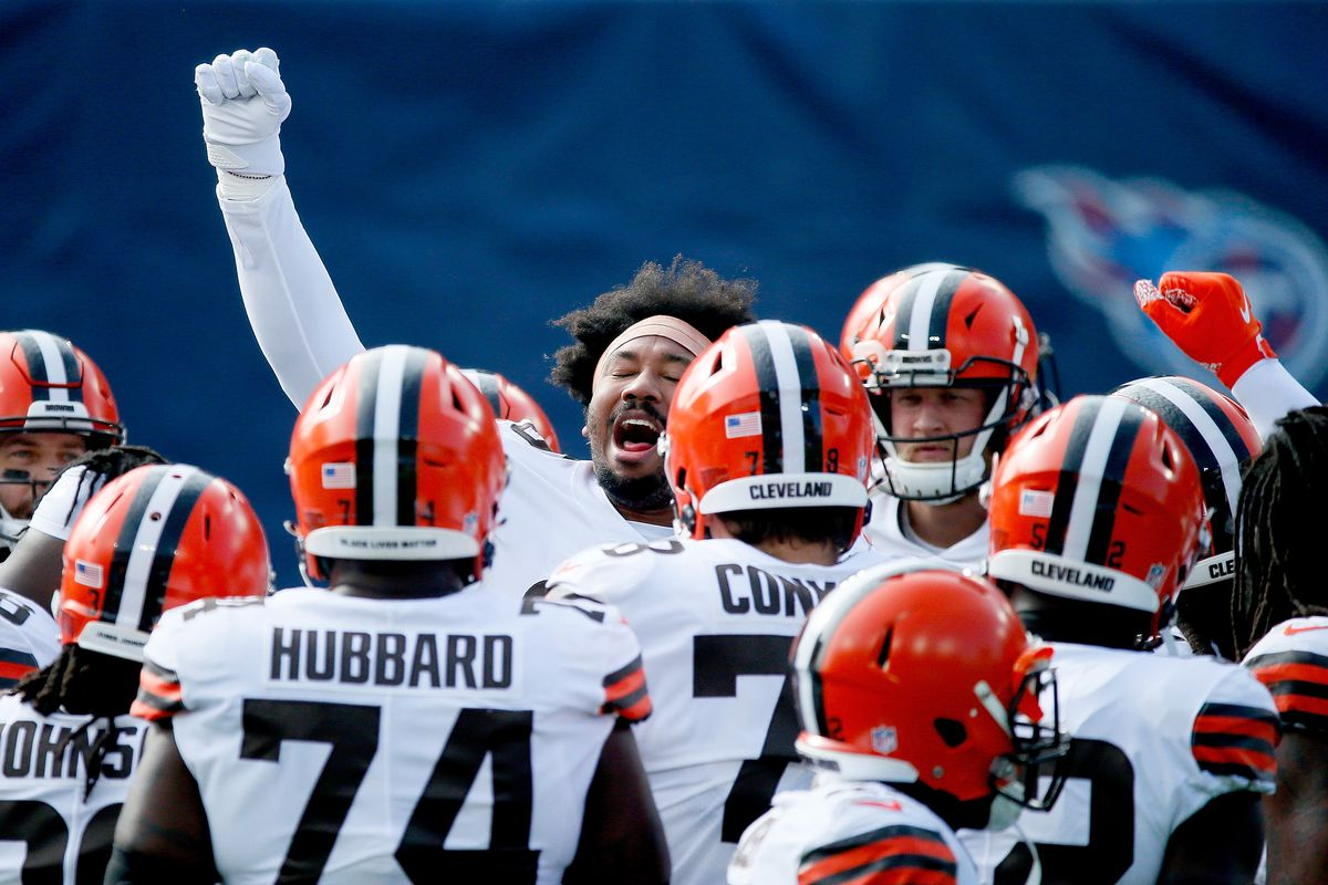 Myles Garrett #95of the Cleveland Browns huddles with his teammates after warmups prior to their game against the Tennessee Titans at Nissan Stadium on December 06, 2020 in Nashville, Tennessee.