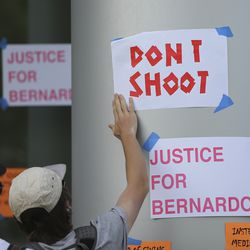 Signs are posted on the Salt Lake County District Attorney's office during a protest for Bernardo Palacios-Carbajal in Salt Lake City on Thursday, June 18, 2020. Palacios-Carbajal was shot and killed by Salt Lake police May 23, 2020.