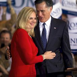 In this March 20, 2012 file photo, Republican presidential candidate, former Massachusetts Gov. Mitt Romney, and his wife Ann hug during a victory rally in Schaumburg, Ill.