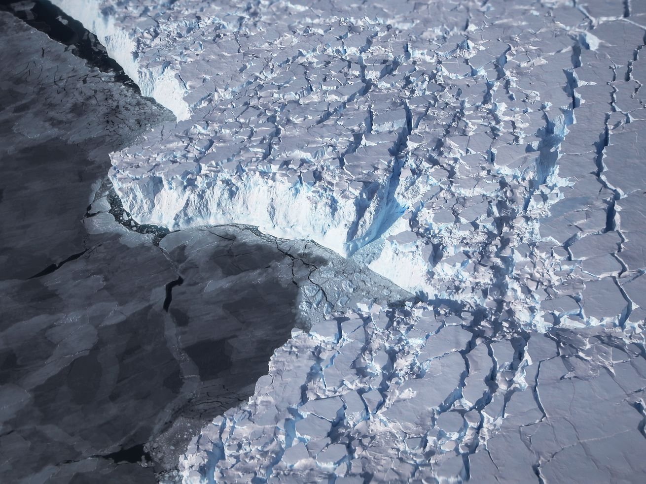 Ice in west Antarctica meets the ocean. The continent's ice is melting at an accelerating rate.