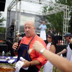 Andrew Zimmern dishes out bites at Saturday afternoon's grilling demonstration. // photo by Andrea Grimes