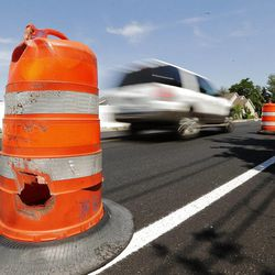Motorists drive through road construction in Farmington, Tuesday, June 30, 2015. Eighty Utah cities and towns passed or considered resolutions this month to support increased transportation funding to meet critical community needs. The funding option was made possible by HB 362.