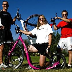 Chris Cox, left, and Sarah Cox have set up Kick-it Marketing to sell footbikes in Idaho and Utah. At right is Mountain Land Rehabilitation therapist Nylin Johnson, who uses footbikes in his work with patients.