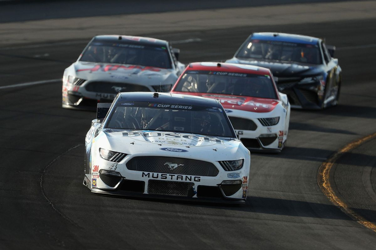 Kevin Harvick, driver of the #4 Busch Head for the Mountains Ford, leads a pack of cars during the NASCAR Cup Series Pocono 350 at Pocono Raceway on June 28, 2020 in Long Pond, Pennsylvania.