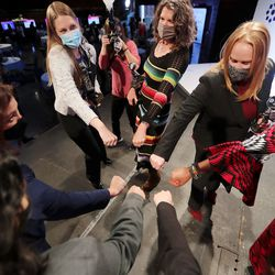 Award recipients put their fists into a circle for a cheer at the conclusion of the Women Tech aat Thanksgiving Point in Lehi on Wednesday, Oct. 28, 2020. The awards recognized the women and innovations spurring economic growth, driving innovation and fighting COVID-19.