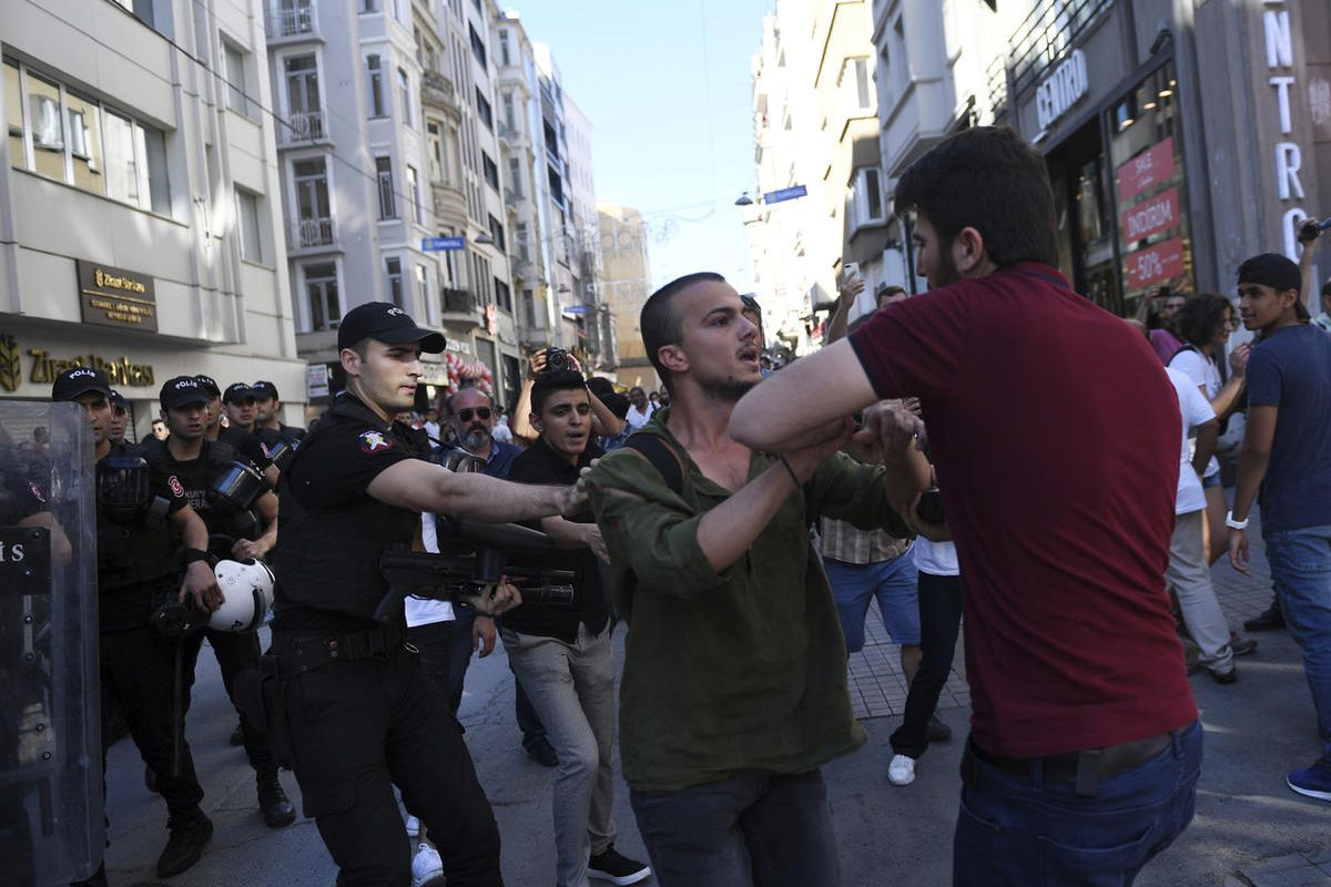 Riot police move to detain a man as they stop protesters for lesbian, gay, bisexual, trans and intersex rights from gathering in large numbers for LGBT Pride protest following a ban issued by the governor, in Istanbul, Sunday, June 25, 2017.  The Istanbul