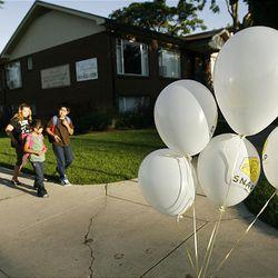 Brandi Barrett, Cheyenne Arnold, Christina Lopez and Anthony Torres walk to school.