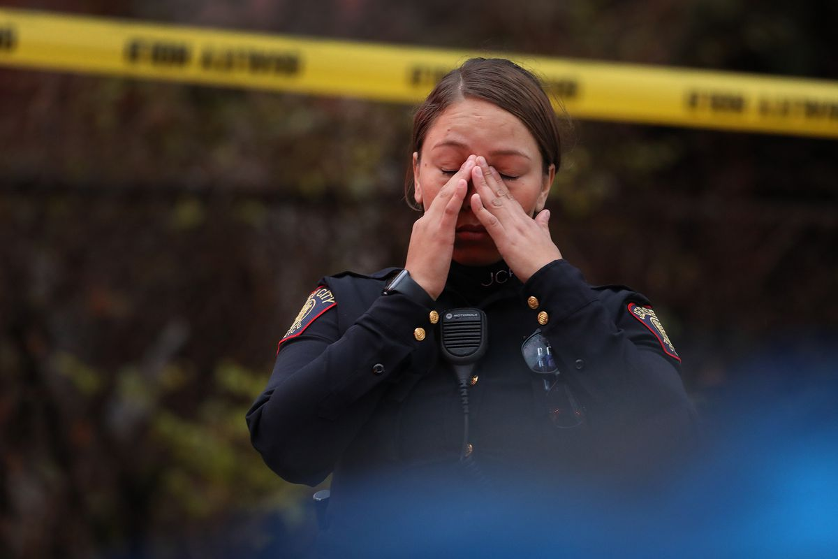 A Jersey City, New Jersey, police officer reacts at the scene of a mass shooting on December 10, 2019.