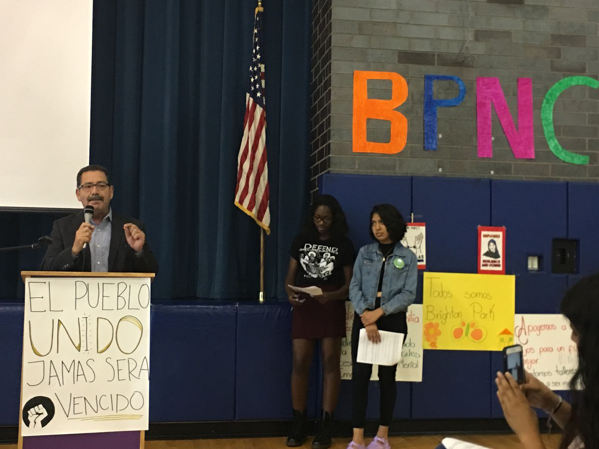 """Cook County commissioner Jesus """"Chuy"""" García (left) speaks at a community event organized by Brighton Park Neighborhood Council at James Shields Middle School."""