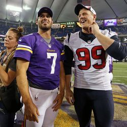 Aug 9, 2013; Minneapolis, MN, USA; Minnesota Vikings quarterback Christian Ponder (7) and Houston Texans defensive tackle Daniel Muir (99) talk after the game at the Metrodome. The Texans won 27-13.