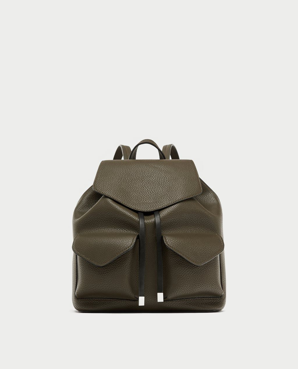 An olive faux leather backpack with pockets