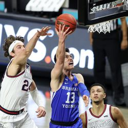 Brigham Young Cougars guard Alex Barcello (13) puts in a shot with Gonzaga Bulldogs forward Corey Kispert (24) and Gonzaga Bulldogs guard Jalen Suggs (1) defending him as BYU and Gonzaga play in the finals of the West Coast Conference tournament at the Orleans Arena in Las Vegas on Tuesday, March 9, 2021.
