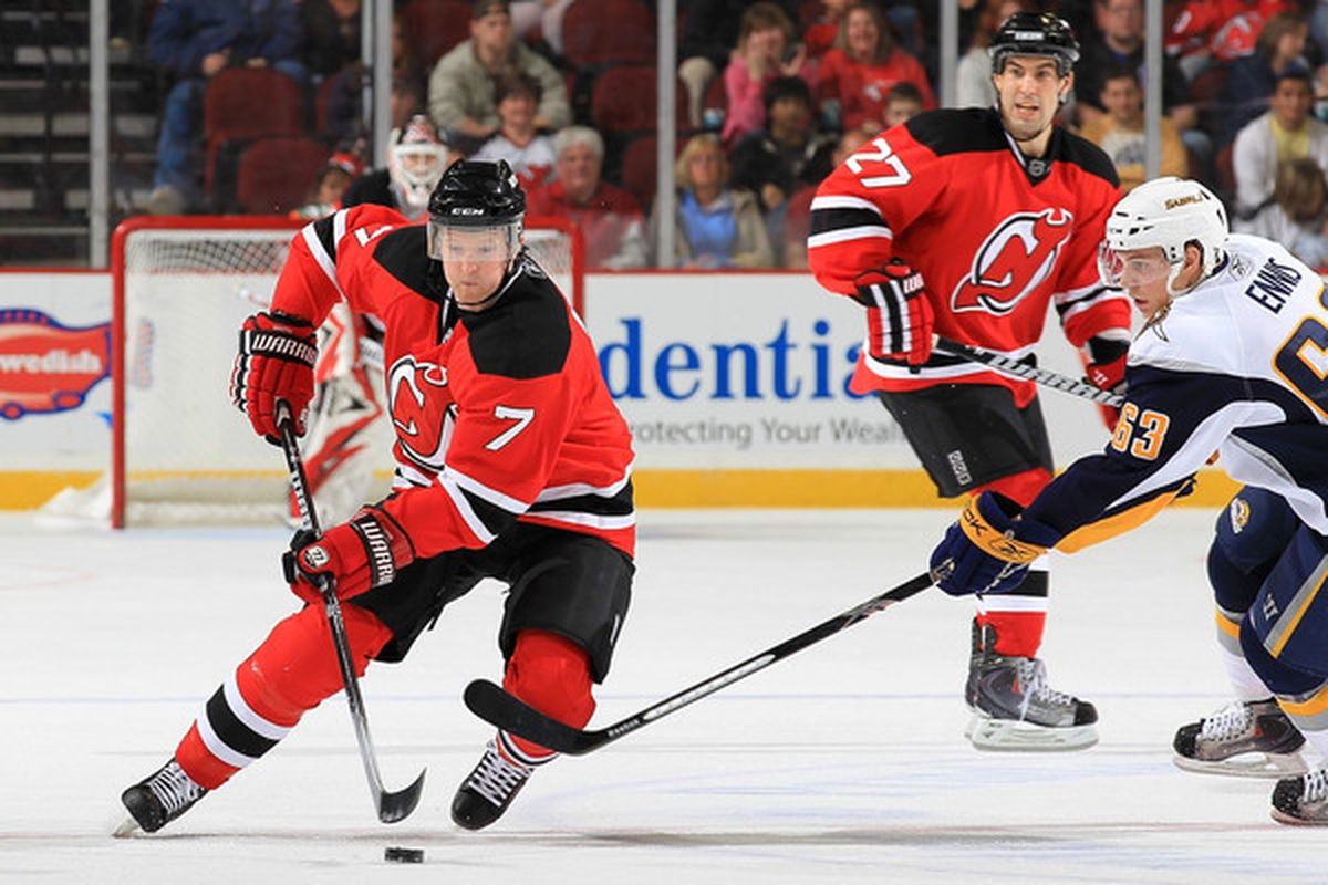 NEWARK, NJ - APRIL 11: Paul Martin #7 of the New Jersey Devils gets away from Tyler Ennis #63 of the Buffalo Sabres at the Prudential Center on April 11, 2010 in Newark, New Jersey.  (Photo by Chris McGrath/Getty Images)