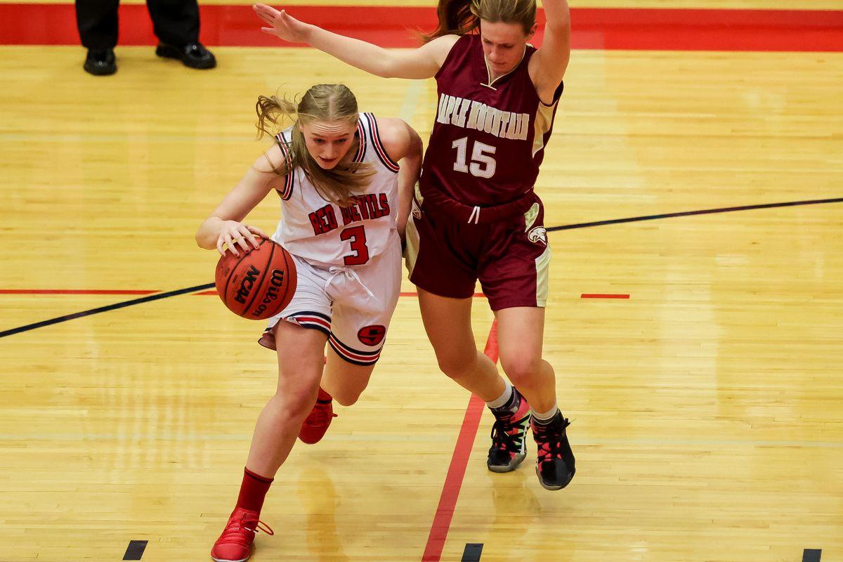 Springville's Kayla Jackson drives against Maple Mountain's Sheridan Liggett in a girls basketball game in Springville on Tuesday, Jan. 26, 2021.