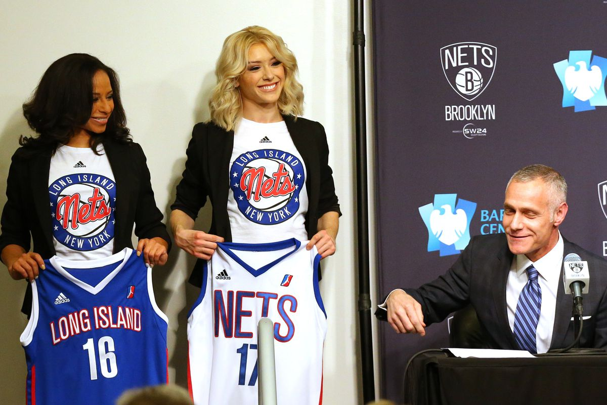 Two members of the Brooklynettes display Long Island's jersey and logo.