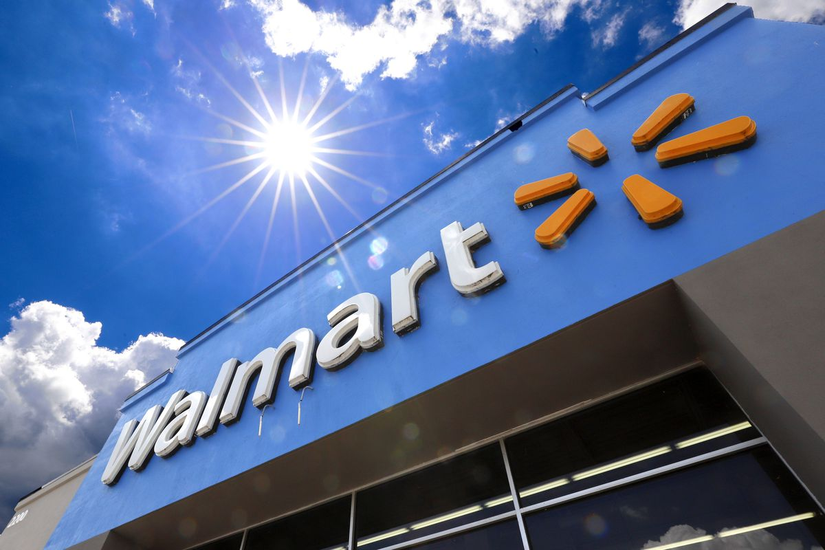 This June 25, 2019, file photo shows the entrance to a Walmart in Pittsburgh. Walmart is spreading out its traditional one-day Black Friday deals over three weekends in November 2020 in an effort to reduce crowds in its stores amid the coronavirus pandemic.