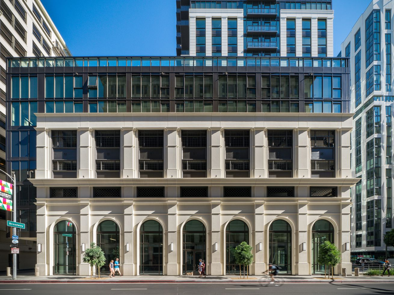 """The exterior of The Griffin on Spring. The 150-foot-tall """"street wall"""" is a nod to the new building's historic surroundings."""