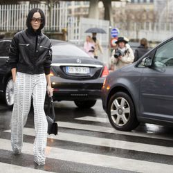Wearing a leather bomber and Loewe trousers en route to the house's runway show.