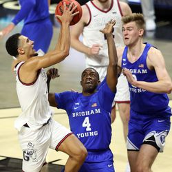 Gonzaga Bulldogs guard Jalen Suggs (1) puts up a shot over Brigham Young Cougars guard Brandon Averette (4) as BYU and Gonzaga play in the finals of the West Coast Conference tournament at the Orleans Arena in Las Vegas on Tuesday, March 9, 2021. Gonzaga won 88-78.