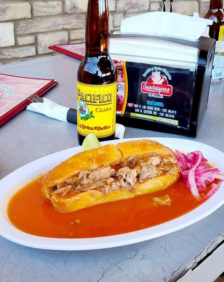 A torta, a bottle of Pacifico, and a napkin