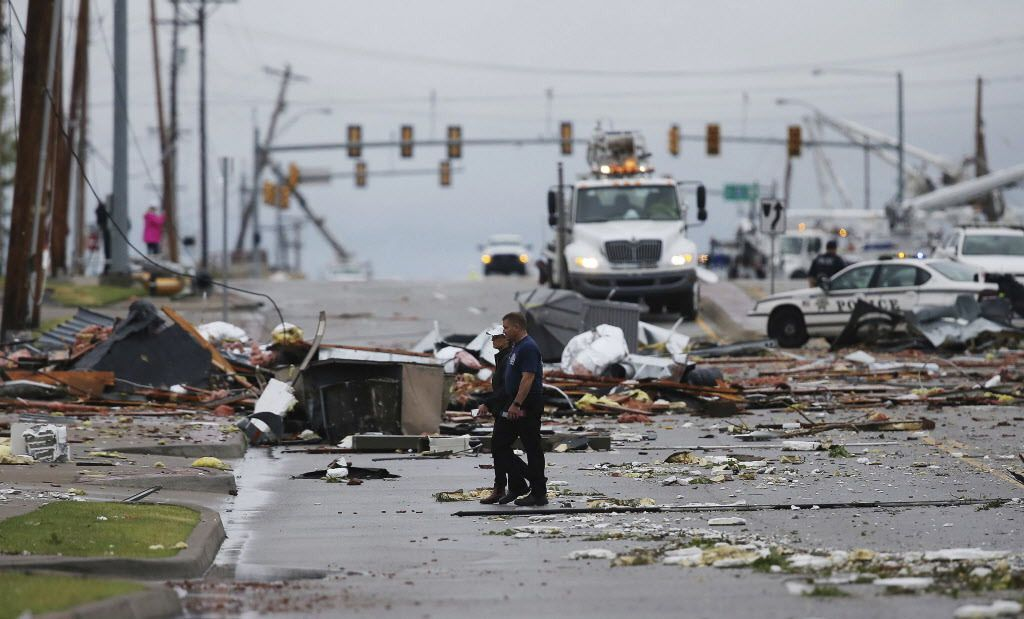 Debris from a storm covers a street in Tulsa on Sunday. | Tom Gilbert/Tulsa World via AP