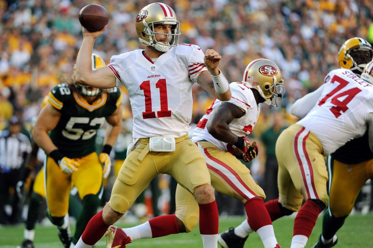 Sept 9, 2012; Green Bay, WI, USA;   San Francisco 49ers quarterback Alex Smith (11) gets off a pass during the game against the Green Bay Packers at Lambeau Field.  Mandatory Credit: Benny Sieu-US PRESSWIRE