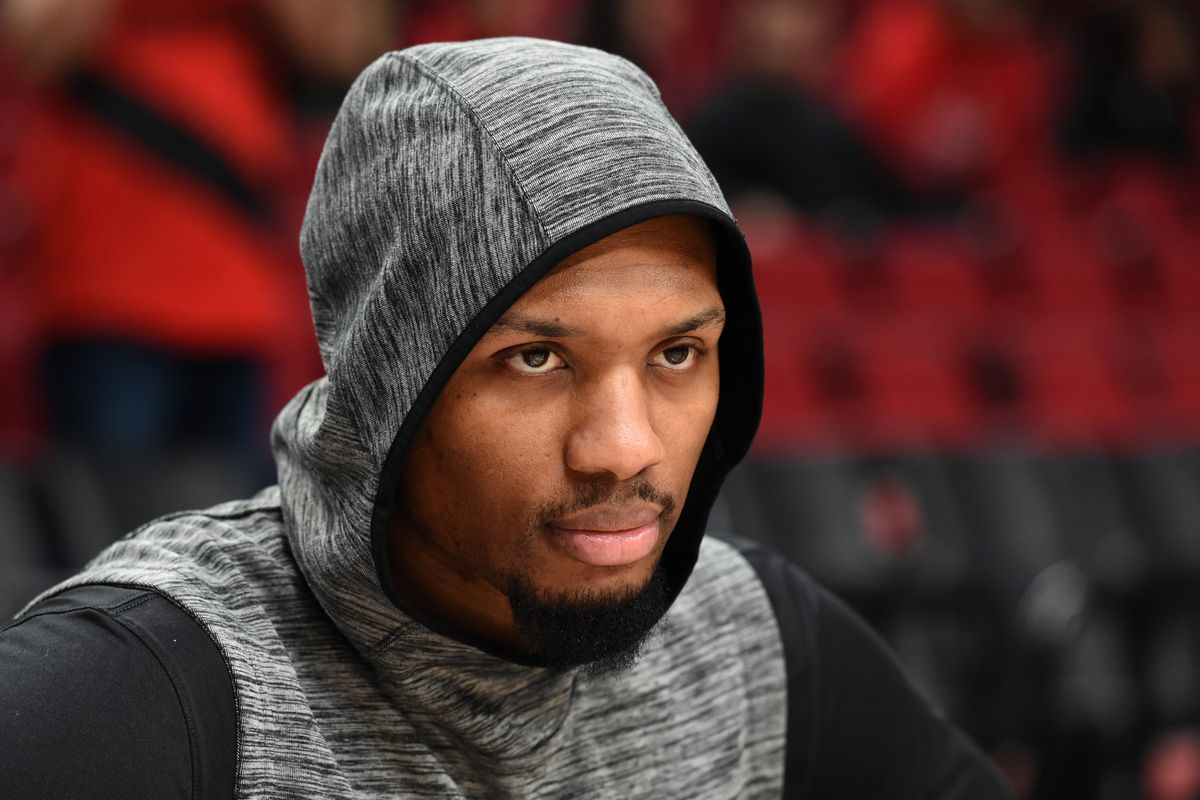 Portland Trail Blazers guard Damian Lillard looks on during warm ups before the game against against the Detroit Pistons at Moda Center.