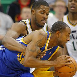 Utah's Derrick Favors defends Warriors' Andre Iguodala as the Utah Jazz and the Golden State Warriors play Tuesday, Oct. 8, 2013 in preseason action at Energy Solutions arena in Salt Lake City.