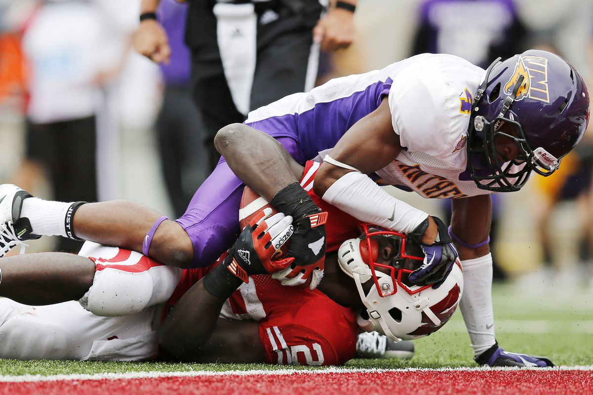 DB Varmah Sonie of Northern Iowa makes a tackle back in his college days.