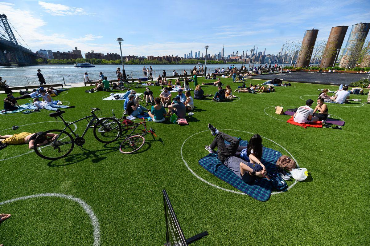 People practice social distancing in Domino Park in Williamsburg during the coronavirus pandemic on May 17 in New York City.