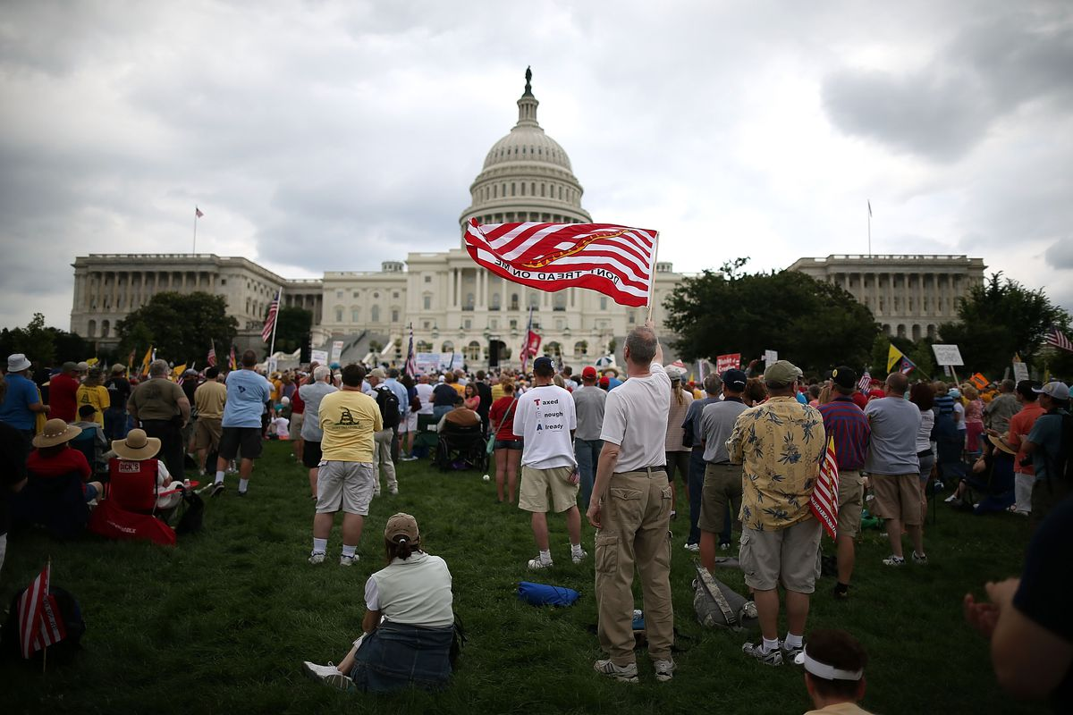 People attend a Tea Party rally in front of the US Capitol, June 17, 2013, in Washington, DC.