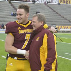 Tommy Lazzaro shakes hands with Jim McElwain during Senior Day ceremonies.