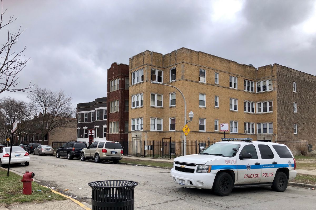 A Chicago police SUV sits at the entrance of the 3900 block of West Van Buren Street on Tuesday afternoon.