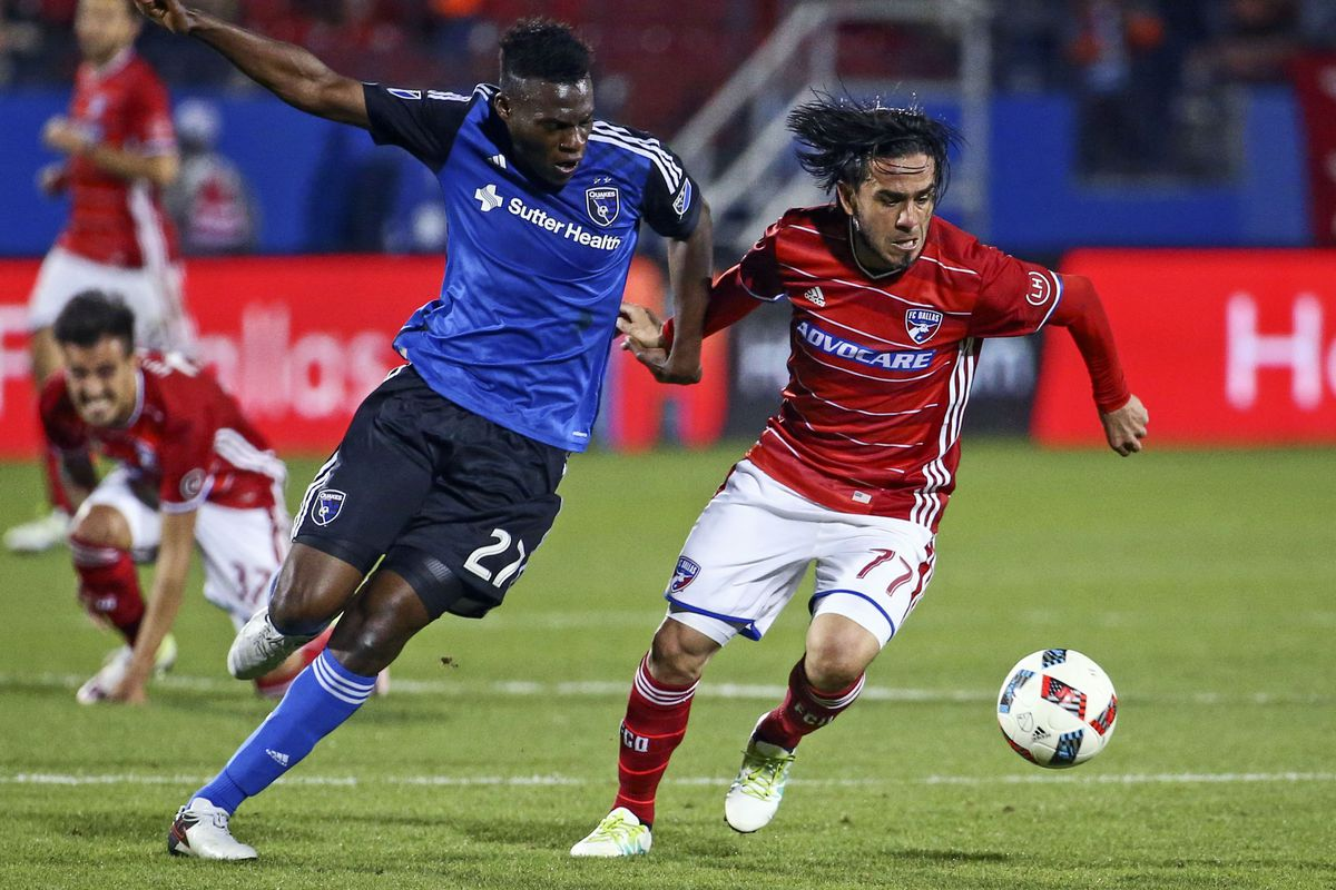 Fatai Alashe battles Mauro Rosales for the ball in a match earlier this season