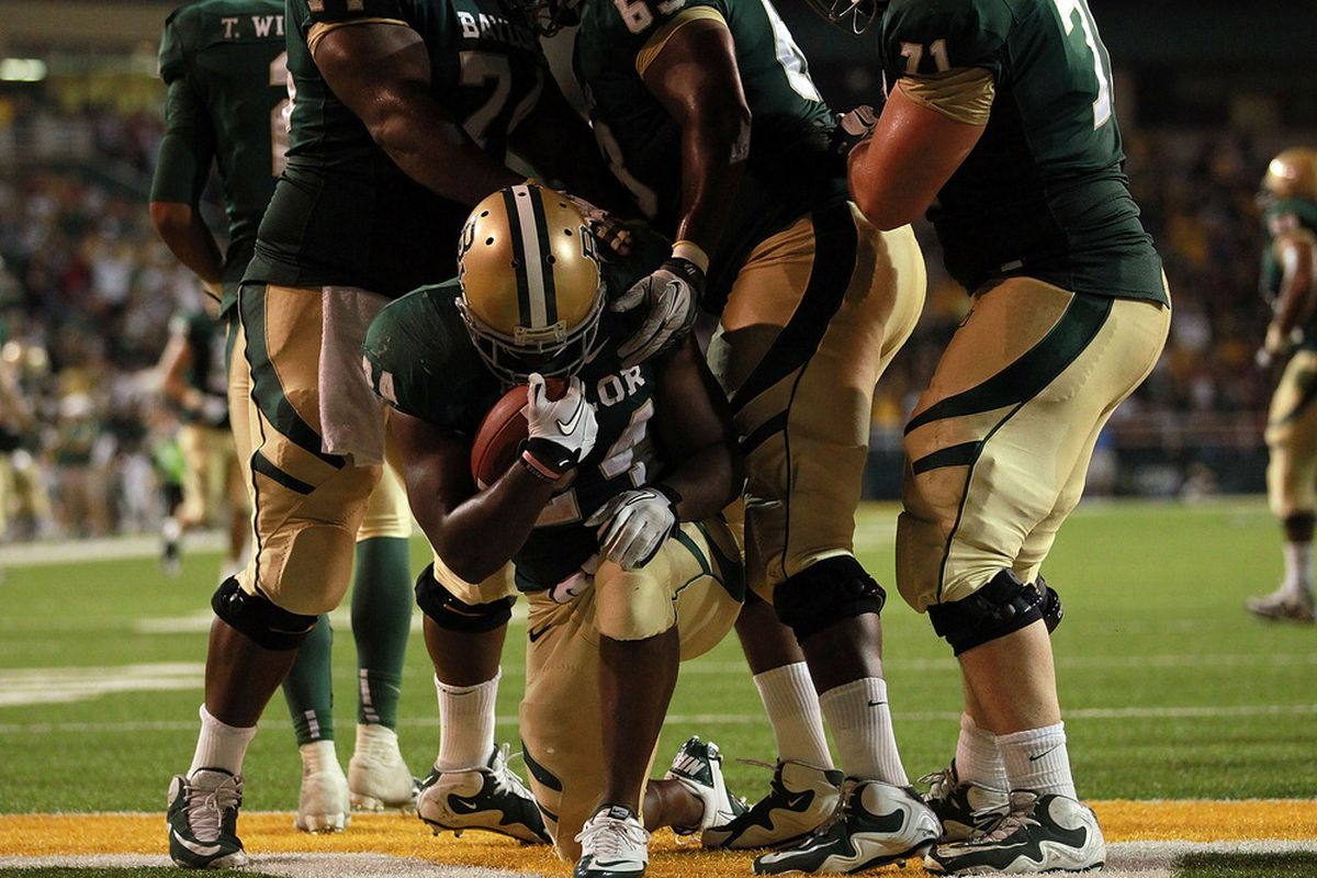 WACO, TX - NOVEMBER 19:  Terrance Ganaway #24 of the Baylor Bears celebrates his touchdown against the Oklahoma Sooners in the fourth quarter at Floyd Casey Stadium on November 19, 2011 in Waco, Texas.  (Photo by Ronald Martinez/Getty Images)