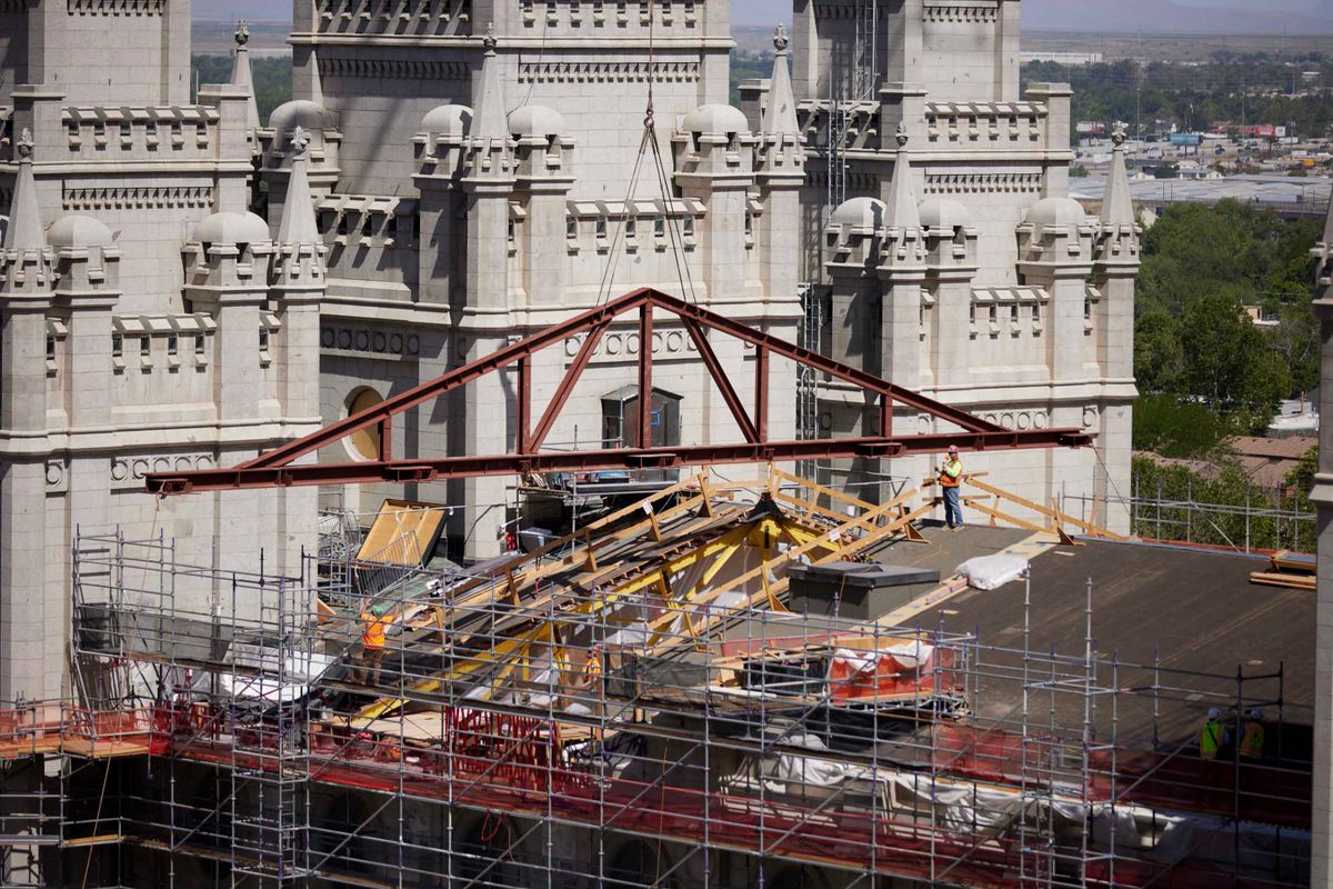Crew members install a new steel truss to help strengthen the seismic design of the Salt Lake Utah Temple.