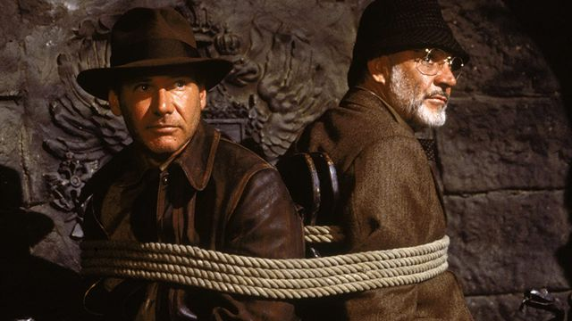 Indiana Jones (Harrison Ford) and Henry Jones (Sean Connery) are tied to a chair