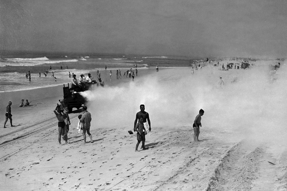 This is a beach in 1945. That giant cloud is DDT.
