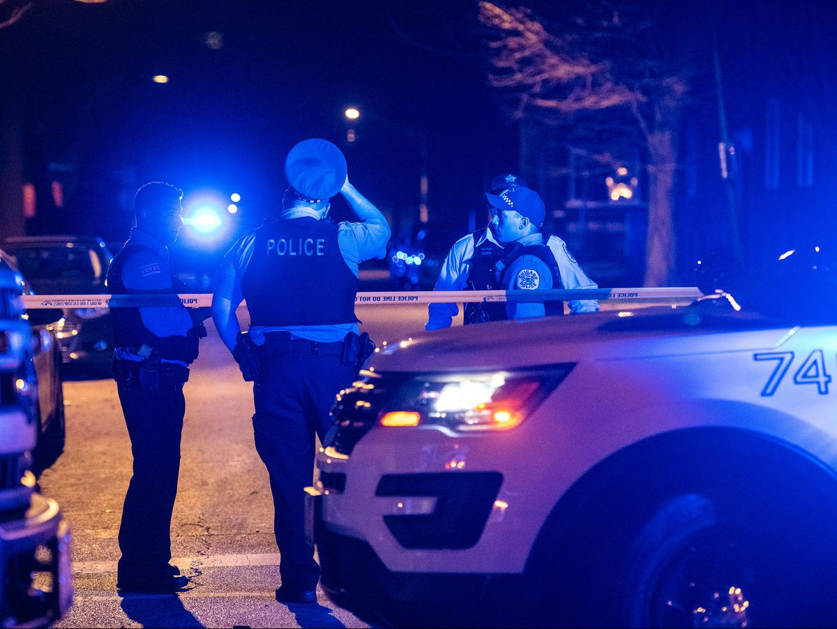 Chicago Police investigate the scene where two people were shot, Sunday night, in the 1300 block of West 56th Street, in the Englewood neighborhood. | Tyler LaRiviere/Sun-Times